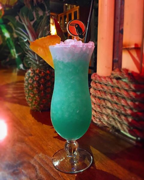 Blue Hawaii Cocktail With Personalized Drink Stirrers At The Jungle Bird.jpg